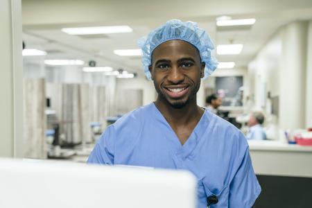 Portrait of smiling Black doctor in hospital LANG_EVOIMAGES
