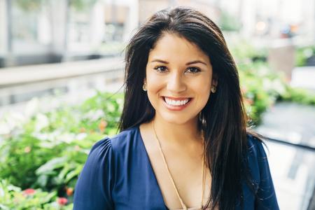 Close up portrait of smiling Hispanic woman Banco de Imagens - 102038028