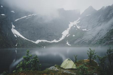 Camping tent near river in fog Banco de Imagens - 102038207