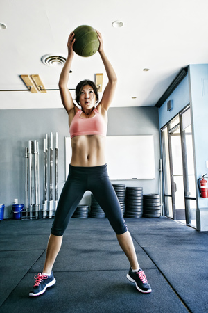 Asian woman working out in gym