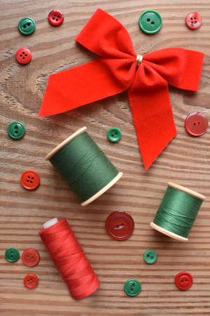Chrismas bow, thread, and sewing buttons