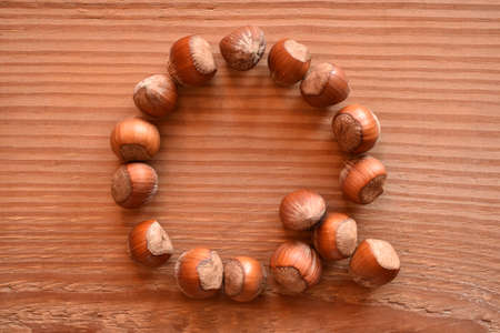 a horizontal of the letter Q made with hazelnuts Stock Photo