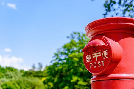 Blue sky and red post