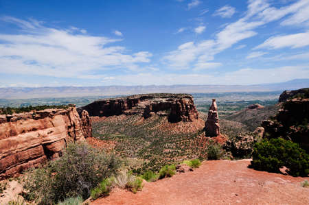 Independence mounment in the Colorado National Monument with Grand Junction, Col in the background