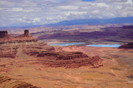 View from Dead horse state park into canyonlands and salt settling ponds Stock Photo