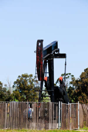 A oil well against a blue sky photo