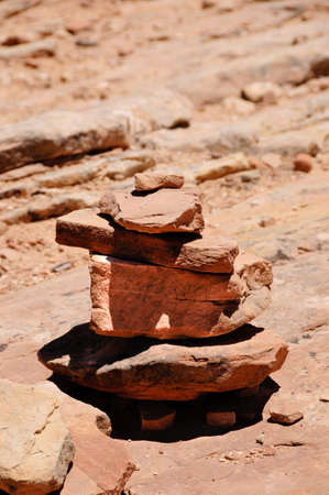 A cairn marking the way on a desert trail