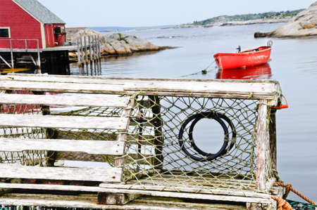Looking thru a lobster trap in a small cove