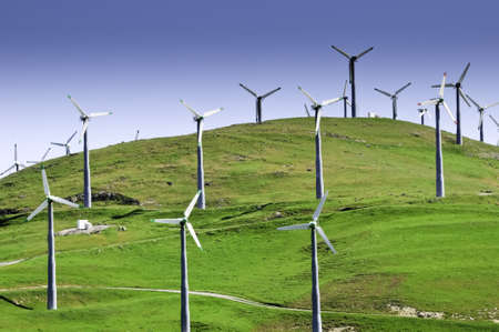 Several wind turbines in the green hills of California