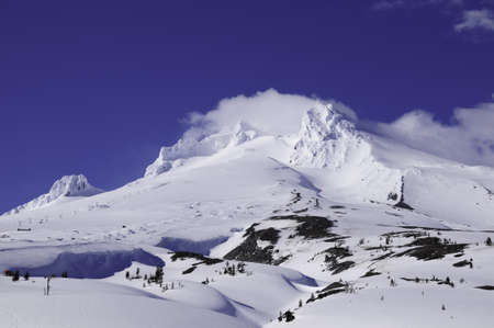Mt. Hood covered in snow with ski lifts photo