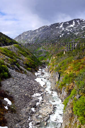 A wooden train trestle between Skagway and White Pass Alaska