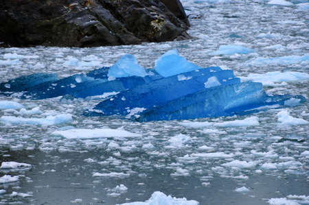 calved: A blue iceburg floating off the sawyer glacier Stock Photo