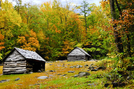 Two old log homes in fall at Smoky Mountain National Park photo