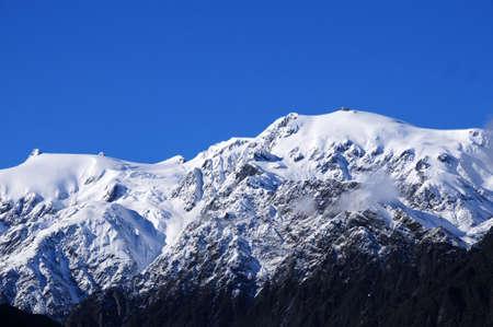 franz josef: Snow covered mountains near Franz Josef glacier New Zealand Stock Photo