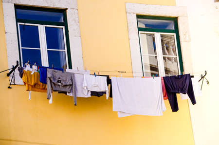 Clothes hanging from an apartment building in the Alfama District of Lisbon Portugal Standard-Bild