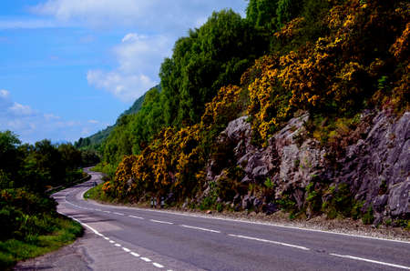 ness: A winding road near Loch Ness in the Scottish Highlands Stock Photo
