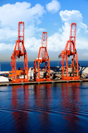 Red shipping cranes and containers at Ensenada Mexico Stock Photo