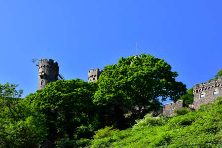 The medieval castle Rheinstein sitting above the Rhine River in Germany.