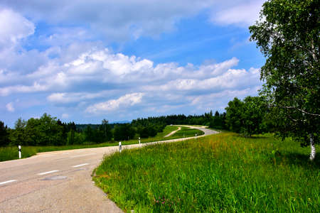 A road going through the German countryside in summer.