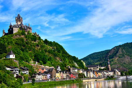 Castle Reichsburg sits above the medieval town of Cochem on the Mosel River, Germany.