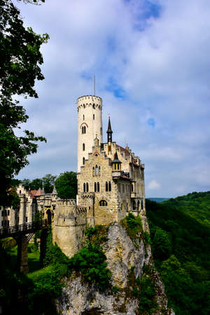 Ancient Lichtenstein Castle perched on a rock in Germany.