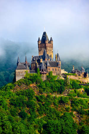 Castle Reichsburg in the fog  in Cochem Germany.