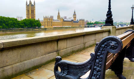 There is a nice pedestrian walk way called the Albert Embankment, along the River Thames in London, with benches. Stock Photo
