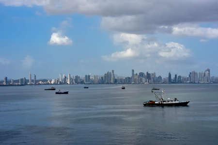 Cityscape of Panama City, Panama and boats in the harbor.