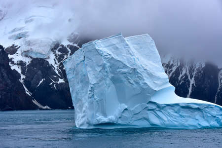 A large blue iceberg floating in Antarctica