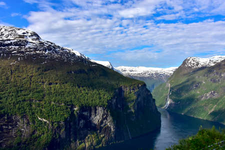 Fjord and waterfalls near Geiranger, Norway.