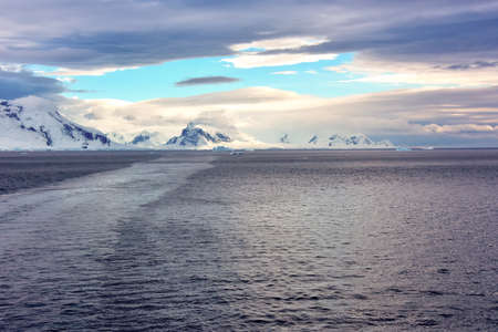 Sun on the mountains while sailing away from Elephant Island, Antartica.