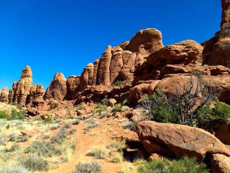 Red rocks and sagebrush at Arches National Park, Utah.