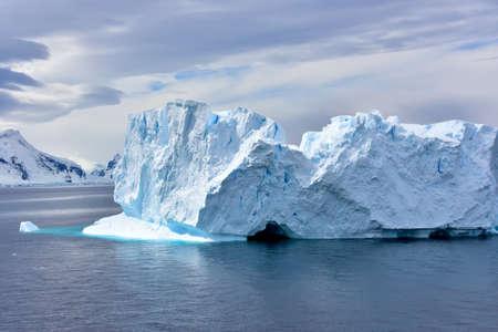 A beautiful blue iceberg floating in Antarctica.