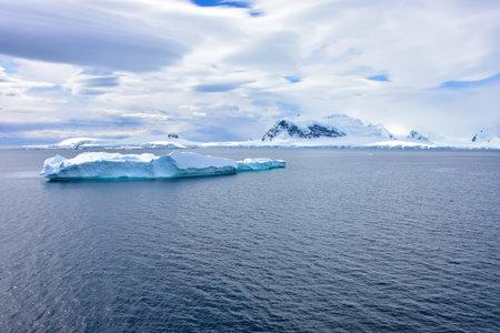 A beautiful blue iceberg floating off Antarctica.