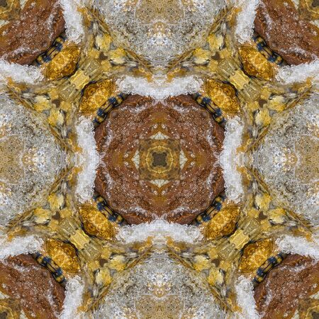Polysimmetrical tracery made of clear water and boulders. The multiaxial kaleidoscope based on yellow and brown river stones No.9