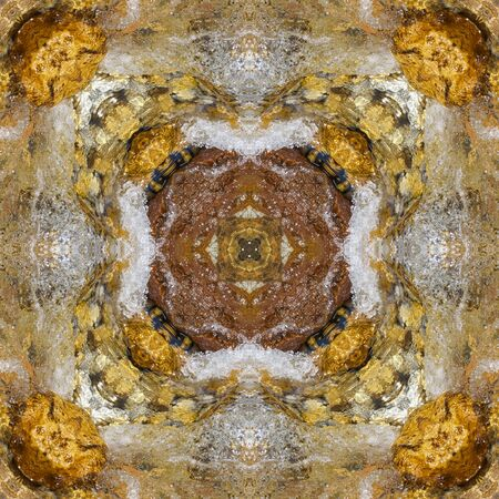 Polysimmetrical tracery made of clear water and boulders. The multiaxial kaleidoscope based on yellow and brown river stones No.7