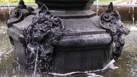 Kiev, Ukraine July 12, 2019: Ancient city fountain with the faces of a lion, Neptune, fish 스톡 콘텐츠