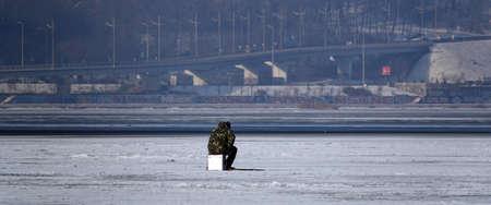 Kiev, Ukraine January 23, 2021: Ice fishing fishermen on ice in winter Stock Photo