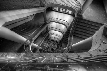 Rusty demolished staircase in abandoned office building