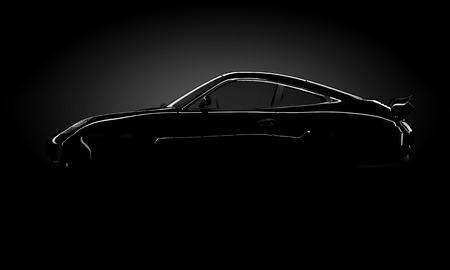 silhouette of a shining car standing in the darkness Archivio Fotografico