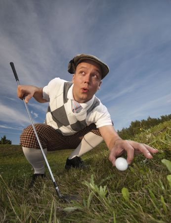 foul: Cheating golfer Stock Photo