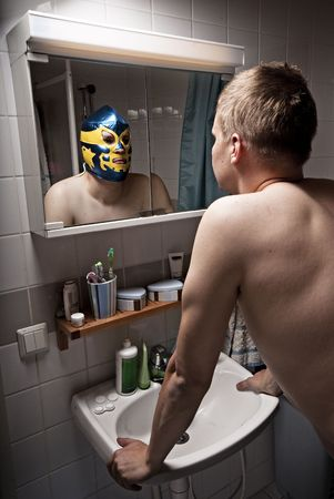 reflection in mirror: Humorous portrait of a man seeing him self as a wrestler.