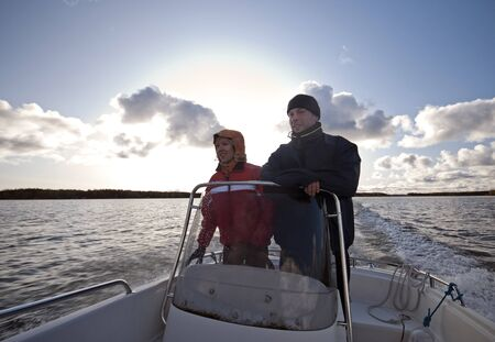 Laughing couple enjoying them self at a boat trip in archipelago of the Bothnia Gulf