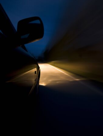 Night Driving. Long exposure of a car driving in night. Stock Photo