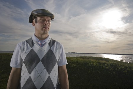 Outdoors portrait of an handsome man wearing a funny hat. photo