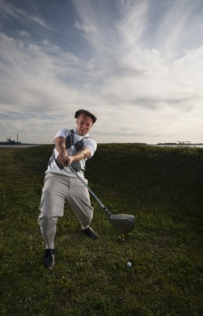 fail: Golfer missing the ball in the rough. Stock Photo