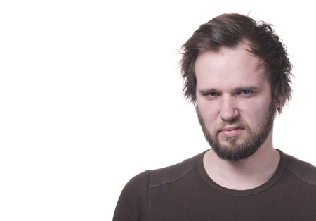 tension: Grumpy man with copy-space. Stock Photo