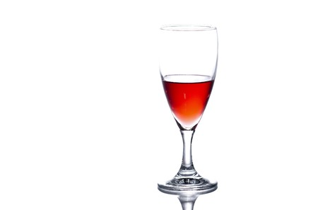 A glass of translucent red wine on white background. Stock Photo - 8035731