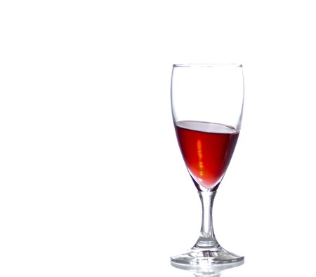 Wineglass on a sloping surface with copy space. Stock Photo