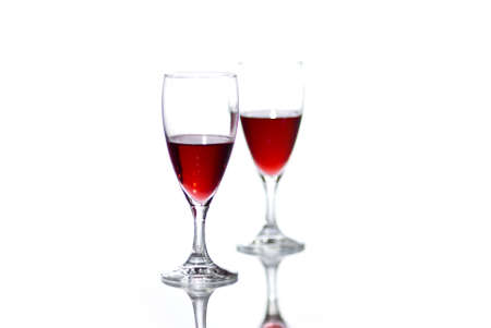 Two glasses of red wine on white background with reflection. Stock Photo - 8035732